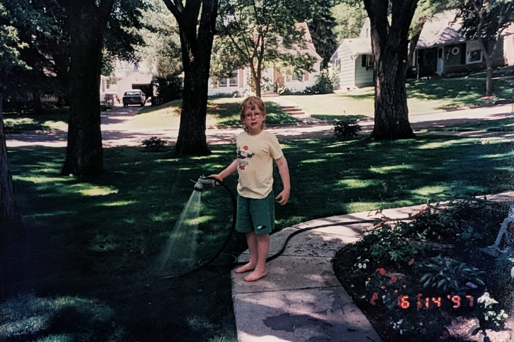 Sean watering lawn in Richfield in 1997