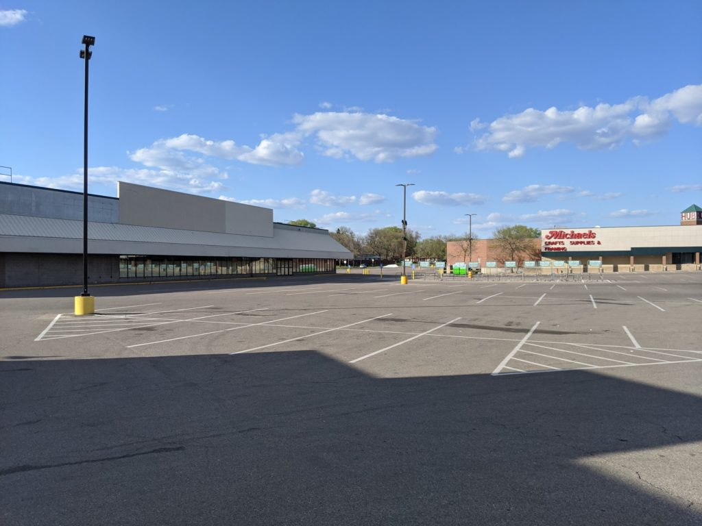 Empty parking lot of Rainbow Foods at the Hub