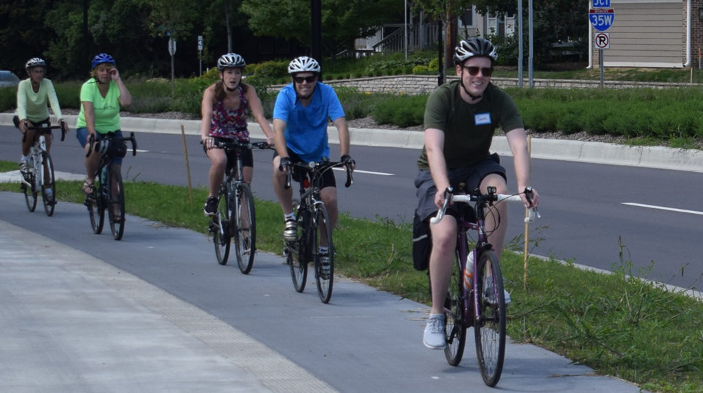 Leading a community bike ride to celebrate 66th